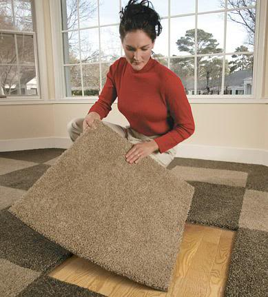 Carpet Tiles Being Installed Indoors